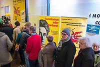 """24. Rosa Luxemburg-Konferenz der Tageszeitung """"junge """"Welt"""" am Samstag den 12. Januar 2019 in Berlin.<br /> Im Bild: Konfernzteilnehmer am Eingang.<br /> 12.1.2019, Berlin<br /> Copyright: Christian-Ditsch.de<br /> [Inhaltsveraendernde Manipulation des Fotos nur nach ausdruecklicher Genehmigung des Fotografen. Vereinbarungen ueber Abtretung von Persoenlichkeitsrechten/Model Release der abgebildeten Person/Personen liegen nicht vor. NO MODEL RELEASE! Nur fuer Redaktionelle Zwecke. Don't publish without copyright Christian-Ditsch.de, Veroeffentlichung nur mit Fotografennennung, sowie gegen Honorar, MwSt. und Beleg. Konto: I N G - D i B a, IBAN DE58500105175400192269, BIC INGDDEFFXXX, Kontakt: post@christian-ditsch.de<br /> Bei der Bearbeitung der Dateiinformationen darf die Urheberkennzeichnung in den EXIF- und  IPTC-Daten nicht entfernt werden, diese sind in digitalen Medien nach §95c UrhG rechtlich geschuetzt. Der Urhebervermerk wird gemaess §13 UrhG verlangt.]"""