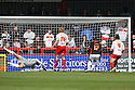Patrick Bamford of MK Dons (out of picture) puts them ahead. Stevenage v MK Dons - npower League 1 -  Lamex Stadium, Stevenage - 27th April, 2013. © Kevin Coleman 2013. ..