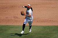 Baltimore Orioles shortstop Freddy Galvis (2) throws to first base during a Major League Spring Training game against the Philadelphia Phillies on March 12, 2021 at the Ed Smith Stadium in Sarasota, Florida.  (Mike Janes/Four Seam Images)