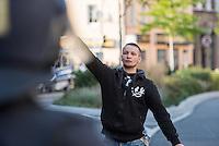 """Ca. 500 Menschen demonstrierten am Freitag den 31. Juli 2015 im Saechsischen Feital gegen Rassismus und fuer die Aufnahme von Fluechtlingen.<br /> Nach mehreren Wochen rassistischer Uebergriffe und Bedrohungen durch einen Teil der Freitaler Bevoelkerung war dies ein Zeichen der Solidaritaet mit den gefleuchteten Menschen.<br /> Am Rande der Demonstration kam es immer wieder zu rassistischen Poebeleien, Flaschenwuerfen und versuchten Angriffen auf die Demonstranten durch Neonazis und Hooligans die sich vor ihrer Stammkneipe """"Timba"""" versammelt hatten. Vereinzelt ging die Polizei gegen die Rechten vor und nahm mindestens eine Person wegen zeigen eines Hitlergrusses fest. Die Flaschenwuerfe blieben fuer die Rechten folgenlos.<br /> Im Bild: Ein Neonazi zeigte mehrfach in Richtung der Demonstranten einen Hitlergruß. Es blieb fuer ihn folgenlos.<br /> 31.7.2015, Freital/Sachsen<br /> Copyright: Christian-Ditsch.de<br /> [Inhaltsveraendernde Manipulation des Fotos nur nach ausdruecklicher Genehmigung des Fotografen. Vereinbarungen ueber Abtretung von Persoenlichkeitsrechten/Model Release der abgebildeten Person/Personen liegen nicht vor. NO MODEL RELEASE! Nur fuer Redaktionelle Zwecke. Don't publish without copyright Christian-Ditsch.de, Veroeffentlichung nur mit Fotografennennung, sowie gegen Honorar, MwSt. und Beleg. Konto: I N G - D i B a, IBAN DE58500105175400192269, BIC INGDDEFFXXX, Kontakt: post@christian-ditsch.de<br /> Bei der Bearbeitung der Dateiinformationen darf die Urheberkennzeichnung in den EXIF- und  IPTC-Daten nicht entfernt werden, diese sind in digitalen Medien nach §95c UrhG rechtlich geschuetzt. Der Urhebervermerk wird gemaess §13 UrhG verlangt.]"""