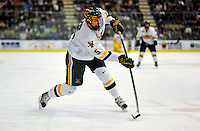 10 January 2009: University of Vermont Catamount forward Brayden Irwin, a Junior from Toronto, Ontario, takes a shot against the Boston College Eagles in the second game of a weekend series at Gutterson Fieldhouse in Burlington, Vermont. The Catamounts rallied from an early 2-0 deficit to defeat the visiting Eagles 4-2. Mandatory Photo Credit: Ed Wolfstein Photo