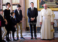 Pope Francis  meets Italian Premier Matteo Renzi and his family during a private audience at the Vatican, on December 13, 2014.