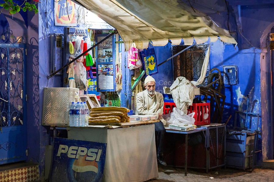 Chefchaouen, Morocco.  Neighborhood Sundries Shop in the Medina at Night.  Bread for Sale.