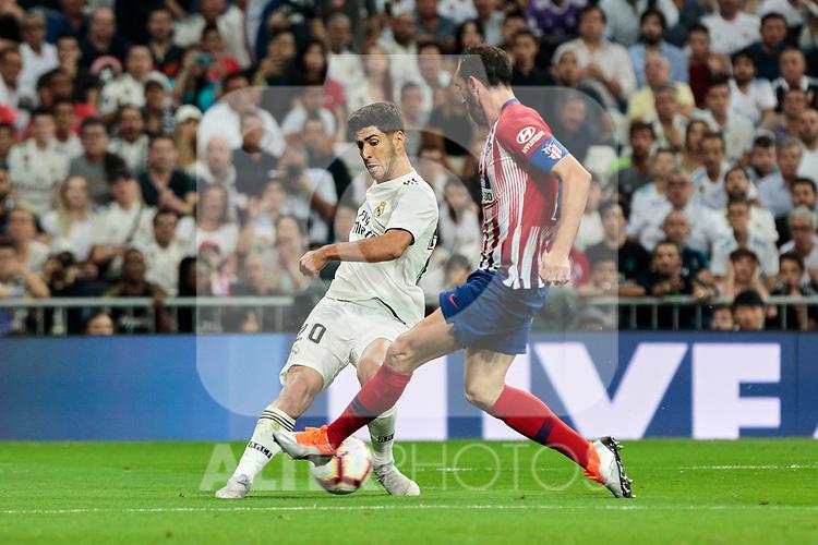 Real Madrid's Marco Asensio and Atletico de Madrid's Juanfran Torres during La Liga match between Real Madrid and Atletico de Madrid at Santiago Bernabeu Stadium in Madrid, Spain. September 29, 2018. (ALTERPHOTOS/A. Perez Meca)