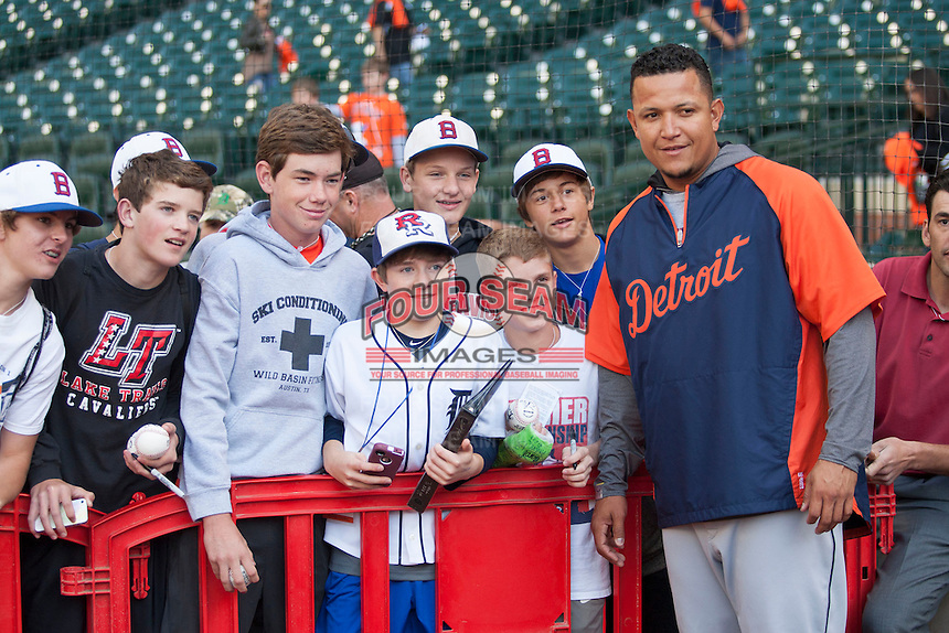 Detroit Tigers third baseman Miguel Cabrera (24) poses for a picture with a group of fans before the MLB baseball game against the Houston Astros on May 3, 2013 at Minute Maid Park in Houston, Texas. Detroit defeated Houston 4-3. (Andrew Woolley/Four Seam Images).