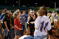 "Arkansas Travelers fan (white hat) raises the ring box after finding the buried diamond ring during the teams annual ""Diamond Dig"", presented by Lee Ann's Fine Jewelry, after a game against the Midland RockHounds on May 25, 2017 at Dickey-Stephens Park in Little Rock, Arkansas.  Midland defeated Arkansas 8-1.  (Mike Janes/Four Seam Images)"