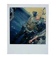 """BNPS.co.uk (01202) 558833. <br /> Pic: PropStore/BNPS<br /> <br /> Pictured: A continuity Polaroid photograph of Barry Tubb as """"Wolfman"""" is included in the sale. <br /> <br /> Costume props and behind-the-scenes photos from the classic Tom Cruise movie Top Gun are coming up for sale.<br /> <br /> The archive includes the white vest worn by Goose, the partner of Tom Cruise's character Pete 'Maverick' Mitchell, during the famous beach volleyball scene. <br /> <br /> There is also the flight suit worn by Maverick's Top Gun rival, Tom 'Iceman' Kazansky, played by Val Kilmer in the 1986 film."""