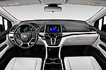 Stock photo of straight dashboard view of 2021 Honda Odyssey LX 5 Door Minivan Dashboard