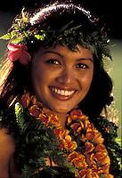 A beautiful Hawaiian girl with ferns and a ilima lei.