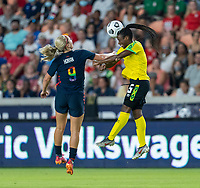 HOUSTON, TX - JUNE 13: Lindsey Horan #9 of the USWNT goes up for a header with Konya Plummer #5 of Jamaica during a game between Jamaica and USWNT at BBVA Stadium on June 13, 2021 in Houston, Texas.
