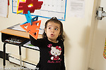 Preschool 2-3 year olds girl flying vehicle constructed from foam pieces, making flying sounds