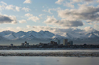 The Anchorage sky line from the deck of USS Anchorage as the ship transits Cook Inlet.