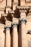 Corintian columns of the Baroque cathedral of St George designed by Rosario Gagliardi , Plaza Duomo, Ragusa Ibla, Sicily.
