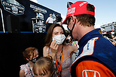 Champion #9 Scott Dixon, Chip Ganassi Racing Honda gets a kiss from wife Emma