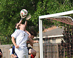 A Lafreniere soccer player battles the keeper while attempting to score a goal. The keeper was unable to handle it and a goal was scored.