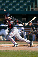 Tyler Pastornicky #3 of the Lansing Lugnuts follows through on his swing versus the South Bend Silver Hawks at Coveleski Stadium April 15, 2009 in South Bend, Indiana. (Photo by Brian Westerholt / Four Seam Images)