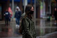 Pictured: A lady walks through Llanelli Town Centre, Llanelli, Wales, UK. Sunday 27 September 2020<br /> Re: Local lockdown will be in force from 6pm on the 27th of September, due to the Covid-19 Coronavirus pandemic, in Llanelli, Wales, UK