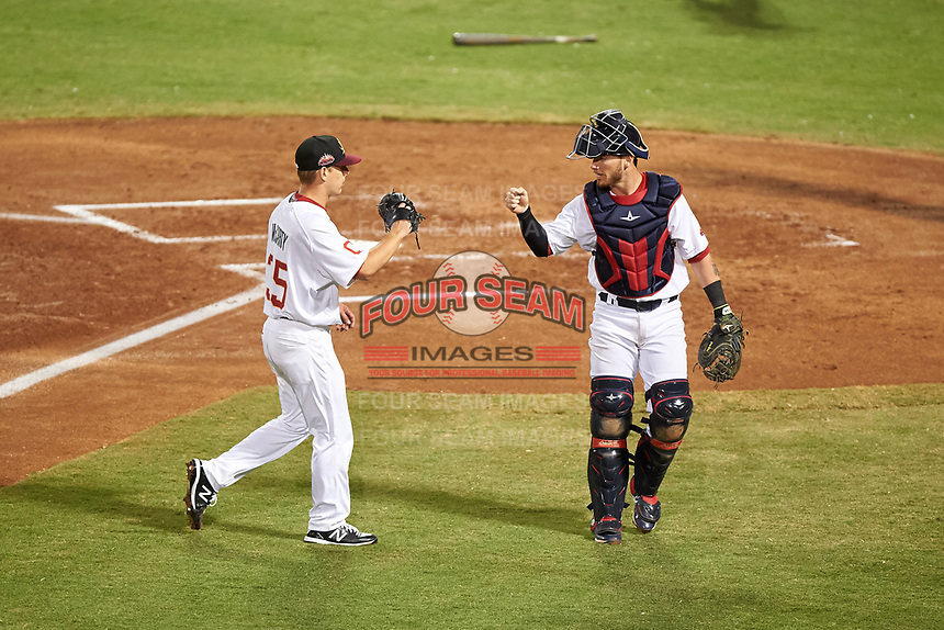 Mesa Solar Sox relief pitcher Kirk McCarty (35) is congratulated by catcher Gavin Collins (12), both of the Cleveland Indians organization, between innings of an Arizona Fall League game against the Peoria Javelinas on September 21, 2019 at Sloan Park in Mesa, Arizona. Mesa defeated Peoria 4-1. (Zachary Lucy/Four Seam Images)
