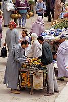 Fez, Morocco - Buying Oranges in the Bab El-Mahrouk Market.