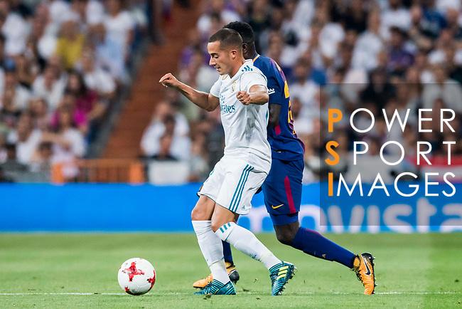 Lucas Vazquez (l) of Real Madrid competes for the ball with Samuel Umtiti of FC Barcelona during their Supercopa de Espana Final 2nd Leg match between Real Madrid and FC Barcelona at the Estadio Santiago Bernabeu on 16 August 2017 in Madrid, Spain. Photo by Diego Gonzalez Souto / Power Sport Images