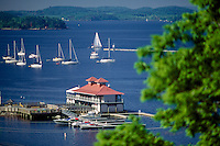 Burlington Boathouse, Burlington, VT.  This new boathouse was built to match the original boathouse that fell into disrepair.  The boathouse has restaurants, music and dockage.  Lake Champlain is the 6th largest lake in the USA.  It is the next largest lake after the Great Lakes and in fact there was a bill proposed in Congress to make it part of the Great Lakes.  The bill failed, but LC is the Greatest Lake.  It borders Vermont, Upstate New York and Canada.  It is 15 miles wide, 115 miles long and 400 feet deep.