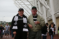 Pictured: Swansea City fans in action <br /> Saturday 20 August 2011<br /> Re: Swansea City FC v Wigan at the Liberty Stadium, Swansea south Wales.