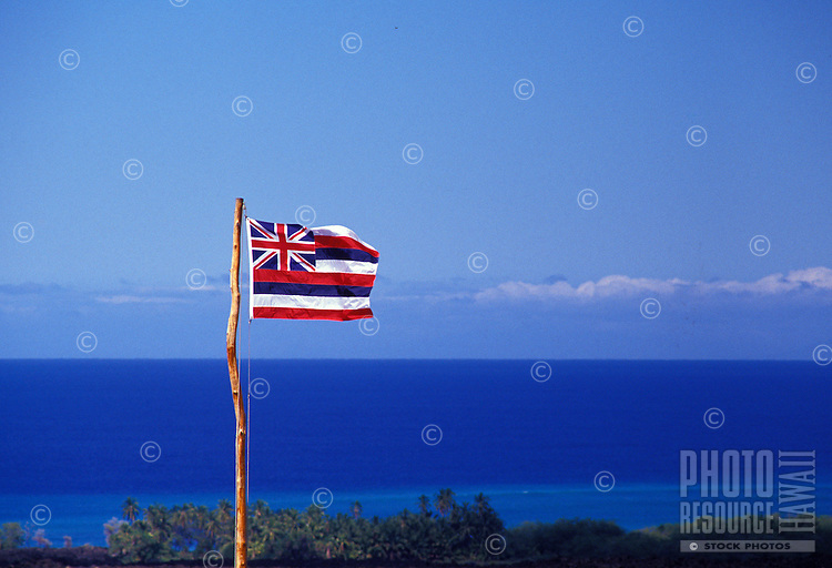 Hawaiian Flag flying over blue skies