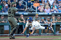 Michigan Wolverines outfielder Jordan Brewer (22) slides into the plate against the Vanderbilt Commodores during Game 1 of the NCAA College World Series Finals on June 24, 2019 at TD Ameritrade Park in Omaha, Nebraska. Michigan defeated Vanderbilt 7-4. (Andrew Woolley/Four Seam Images)