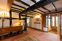 BNPS.co.uk (01202 558833)<br /> Pic: Savills/BNPS<br /> <br /> Pictured: The entrance hall with visible wooden beams in the ceiling.<br /> <br /> A historic thatched home where Cromwell's army stayed during the English Civil War is on the market for £1.6m.<br /> <br /> The Barracks, so-named for its links with Cromwell more than 370 years ago, has spectacular country views and is in one of Cheshire's most popular areas.<br /> <br /> The five-bedroom property just outside the picturesque village of Bunbury is a far cry from how it would have looked in Cromwell's time, having been extended over the years.<br /> <br /> It was used in the 17th century by Cromwell's armies during the siege of Beeston Castle - two miles away. The castle's location made it valuable to both the royalists and parliamentarians.