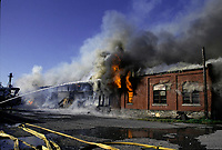 1992 File Photo Montreal (Quebec) CANADA<br /> water jet toward a burning old factory buiding,  No model release<br /> Photo (c) P Roussel / Images Distribution