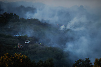 Snoke billows form a forest as firefighters work at the site of a wildfire in Seoane de Oleiros near Ourense on August 25, 2013. (c) Pedro ARMESTRE