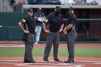 Umpires Stephen Hagan, Chuck Pack and Jason Johnson prior to the NCAA baseball game between the Bellarmine Knights and the Liberty Flames at Liberty Baseball Stadium on March 9, 2021 in Lynchburg, VA. (Brian Westerholt/Four Seam Images)