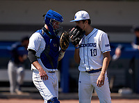 IMG Academy Ascenders catcher Sam Hunt (24) talks with pitcher Jackson Ferris (10) during a game against the Calvary Christian Academy Eagles on March 13, 2021 at IMG Academy in Bradenton, Florida.  (Mike Janes/Four Seam Images)