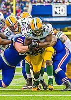 14 December 2014: Green Bay Packers running back Eddie Lacy breaks tackles to gain 22 yards in the first quarter against the Buffalo Bills at Ralph Wilson Stadium in Orchard Park, NY. The Bills defeated the Packers 21-13, snapping the Packers' 5-game winning streak and keeping the Bills' 2014 playoff hopes alive. Mandatory Credit: Ed Wolfstein Photo *** RAW (NEF) Image File Available ***