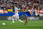 Atletico de Madrid's Diego Godin (R) and Real Madrid´s Gareth Bale during quarterfinal first leg Champions League soccer match at Vicente Calderon stadium in Madrid, Spain. April 14, 2015. (ALTERPHOTOS/Victor Blanco)