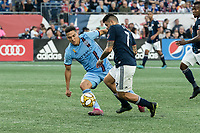 FOXBOROUGH, MA - SEPTEMBER 29: Tony Rocha #15 of New York City FC comes in to tackle Gustavo Bao #7 of New England Revolution during a game between New York City FC and New England Revolution at Gillettes Stadium on September 29, 2019 in Foxborough, Massachusetts.