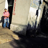 A Mexican man watches the street from the corner during a sunny morning in Buenavista, a neighborhood in Mexico City, Mexico, 29 October 2016.