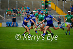 Ballyduffs Paul Carroll can't get hrough the wall of St Brendan's defenders Kevin Orpen and Darren Dineen  in round 2 of the County Hurling Championship