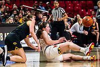 COLLEGE PARK, MD - FEBRUARY 13: Amanda Ollinger #43 of Iowa and Taylor Mikesell #11 of Maryland clash on the floor during a game between Iowa and Maryland at Xfinity Center on February 13, 2020 in College Park, Maryland.
