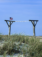 Old outdoor clothes line nestled in dune grass, Dennis, Cape Cod, Massachusetts, USA.