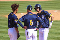 Wisconsin Timber Rattlers shortstop Yeison Coca (1), second baseman Brice Turang (2) and manager Matt Erickson (8) talk during a pitching change in a Midwest League game against the Burlington Bees on April 28, 2019 at Fox Cities Stadium in Appleton, Wisconsin. Wisconsin defeated Burlington 5-4. (Brad Krause/Four Seam Images)