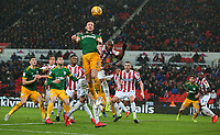 Preston North End's Ben Davies beats Stoke City's Benik Afobe to the ball<br /> <br /> Photographer Stephen White/CameraSport<br /> <br /> The EFL Sky Bet Championship - Stoke City v Preston North End - Saturday 26th January 2019 - bet365 Stadium - Stoke-on-Trent<br /> <br /> World Copyright © 2019 CameraSport. All rights reserved. 43 Linden Ave. Countesthorpe. Leicester. England. LE8 5PG - Tel: +44 (0) 116 277 4147 - admin@camerasport.com - www.camerasport.com