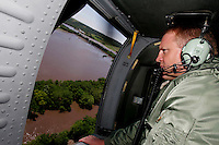 Iowa Gov. Chet Culver surveys flooding damage on the Upper Iowa River near Decorah during a helicopter tour over Iowa, June 10, 2008.