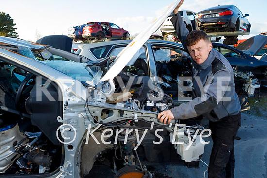 Craig Lynch removing car parts in Relihan's Car Dismantling and Breakers yard