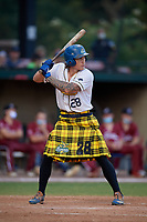 Savannah Bananas Daniel Oberst (28) bats during a Coastal Plain League game against the Macon Bacon on July 15, 2020 at Grayson Stadium in Savannah, Georgia.  Savannah wore kilts for their St. Patrick's Day in July promotion.  (Mike Janes/Four Seam Images)