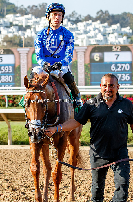 DEL MAR, CA  SEPTEMBER 6:  #5 Mackinnon, ridden by Juan Hernandez, returns to the connections after winning the Del Mar Juvenile Turf on September 6, 2021 at Del Mar Thoroughbred Club in Del Mar, CA. (Photo by Casey Phillips/Eclipse Sportswire/CSM)