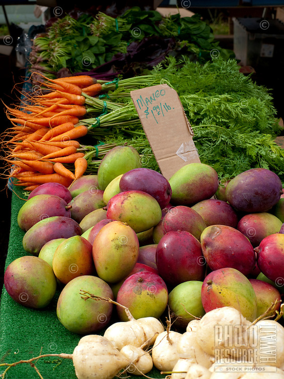 Fresh mangos and carrots sold at the Kapiolani Community College farmers market.