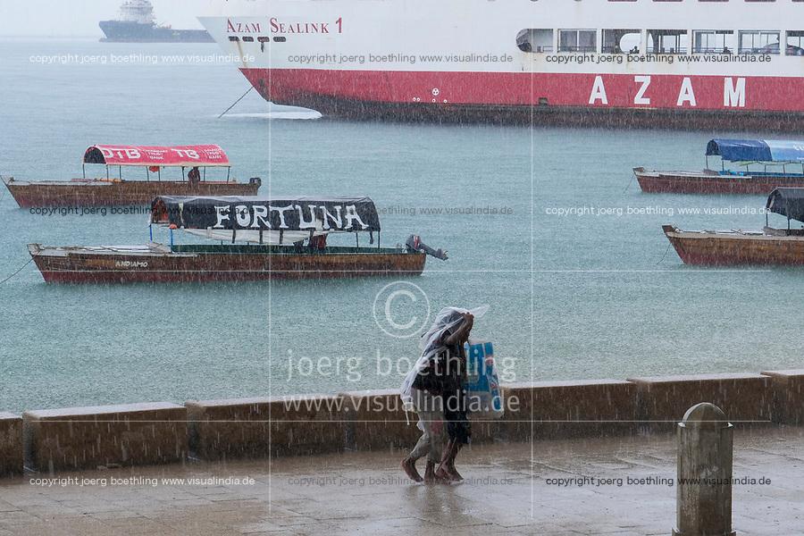 TANZANIA, Zanzibar, Stone town, raining day at port, two boys in rain