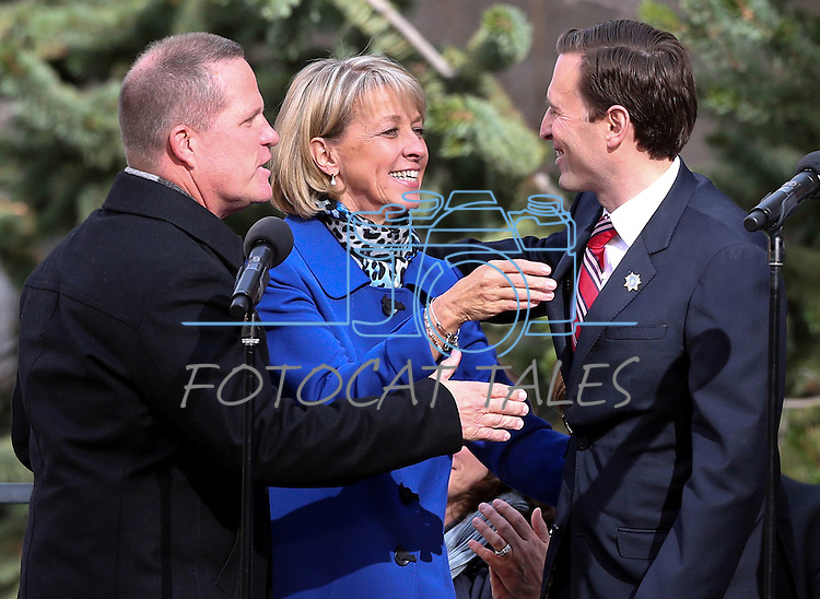 Nevada Constitution officers, from left, Lt. Gov. Mark Hutchison, Secretary of State Barbara Cegavske and Attorney General Adam Laxalt congratulate each other after taking the oath of office on the steps of the Capitol, in Carson City, Nev., on Monday, Jan. 5, 2015. (Las Vegas Review-Journal/Cathleen Allison)
