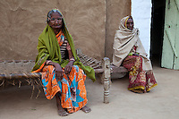 Bharatpur, Rajasthan, India.  Two Old Rajasthani Women Sitting outside their House.